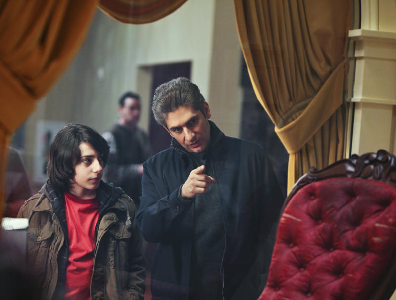 """In this photo supplied by ABC Television, Vadim Imperioli, left, listens to Michael Imperioli on the Season Finale of """"Detroit 1-8-7,"""" airing Sunday, March 20, 2011 on ABC. With three episodes left to air and its future uncertain, the principals behind the ABC crime drama """"Detroit 1-8-7"""" are fighting for a second season - even if that means trying to follow other network cast-offs to eventual success on basic cable. (AP Photo/ABC, Alicia Gbur)"""