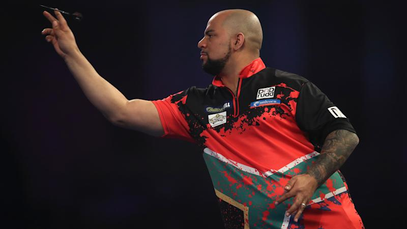 Darts defies shutdown as top stars do battle online from their own homes