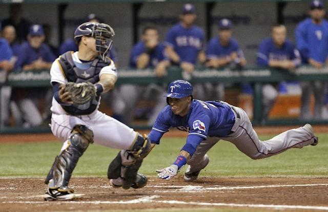 Texas Rangers' Leonys Martin, right, scores before a tag by Tampa Bay Rays catcher Jose Lobaton on a fifth-inning sacrifice fly by teammate Elvis Andrus off Rays pitcher Brandon Gomes during an MLB American League baseball game Tuesday, Sept. 17, 2013, in St. Petersburg, Fla. (AP Photo/Chris O'Meara)