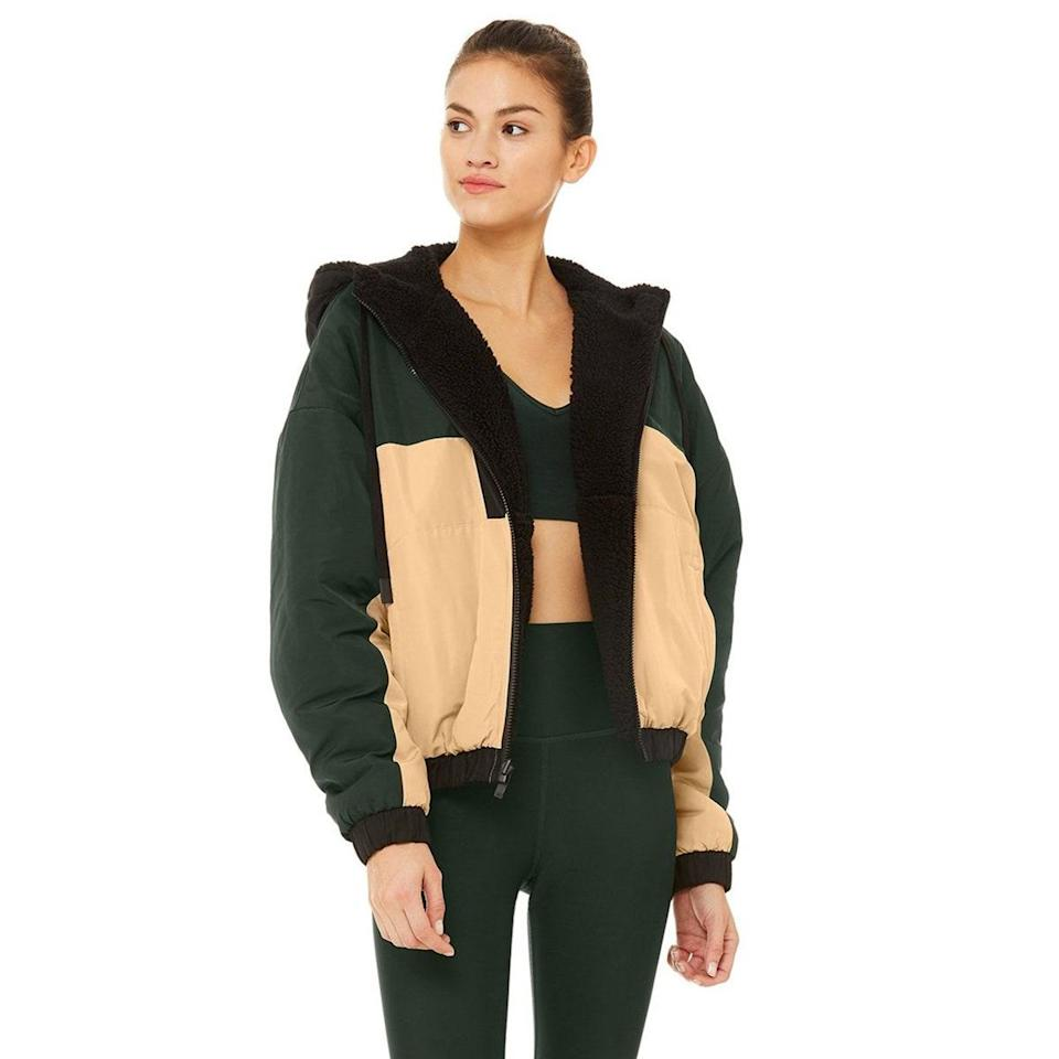 """Why choose one jacket when you can have two in one? Turn this color-block style inside out when you're in the mood to sport the <a href=""""https://www.glamour.com/gallery/best-teddy-coats-to-buy-this-winter?mbid=synd_yahoo_rss"""" rel=""""nofollow noopener"""" target=""""_blank"""" data-ylk=""""slk:teddy coat trend"""" class=""""link rapid-noclick-resp"""">teddy coat trend</a>, or stay extra warm with the plush side turned in. $248, Alo. <a href=""""https://www.aloyoga.com/products/w4367r-duality-reversible-sherpa-jacket-black-putty-forest"""" rel=""""nofollow noopener"""" target=""""_blank"""" data-ylk=""""slk:Get it now!"""" class=""""link rapid-noclick-resp"""">Get it now!</a>"""