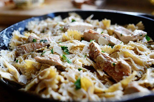 """<p>Bite-size bowtie pasta pairs perfectly with larger chunks of chicken in this recipe. Top with minced parsley for extras pop of color and flavor. </p><p><a href=""""https://www.thepioneerwoman.com/food-cooking/recipes/a10857/bowtie-chicken-alfredo/"""" rel=""""nofollow noopener"""" target=""""_blank"""" data-ylk=""""slk:Get the recipe"""" class=""""link rapid-noclick-resp""""><strong>Get the recipe</strong></a>. </p><p><a class=""""link rapid-noclick-resp"""" href=""""https://go.redirectingat.com?id=74968X1596630&url=https%3A%2F%2Fwww.walmart.com%2Fbrowse%2Fhome%2Fthe-pioneer-woman-cookware%2F4044_623679_6182459_9190581%3Fcat_id%3D4044_623679_6182459_9190581%26facet%3Dfacet_product_type%253ASkillets%2B%2526%2BFrying%2BPans&sref=https%3A%2F%2Fwww.thepioneerwoman.com%2Ffood-cooking%2Fmeals-menus%2Fg37103321%2Fchicken-pasta-recipes%2F"""" rel=""""nofollow noopener"""" target=""""_blank"""" data-ylk=""""slk:SHOP SKILLETS"""">SHOP SKILLETS</a> </p>"""