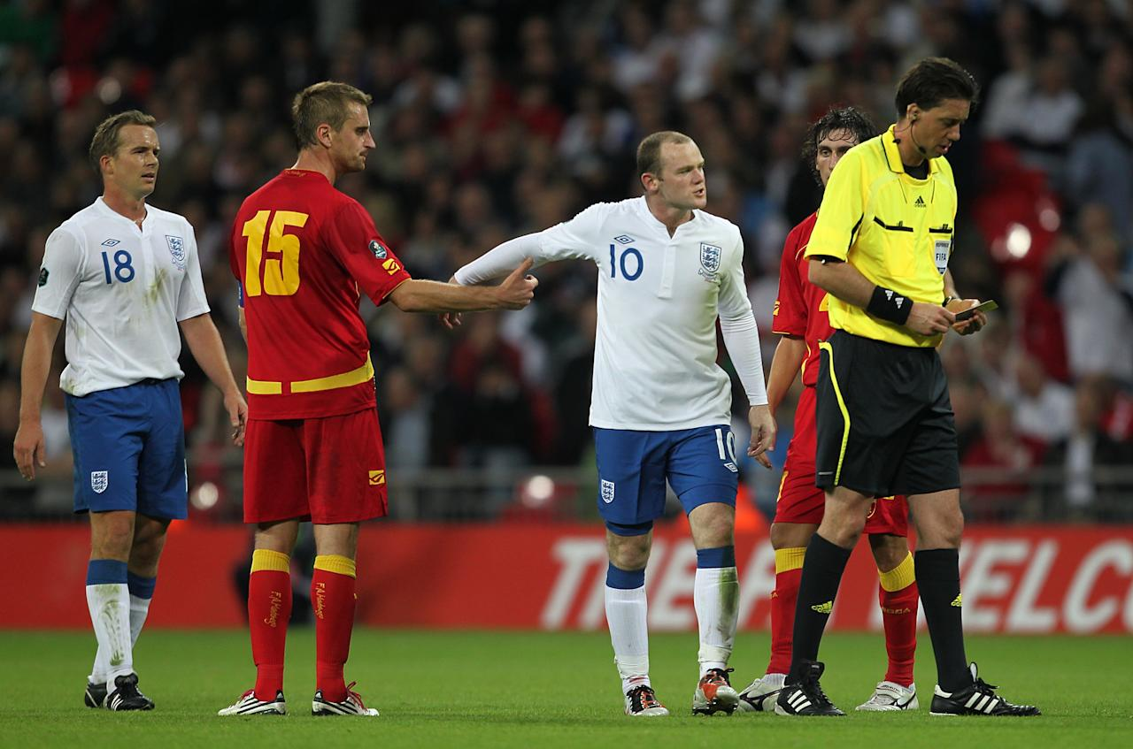 <p>Another red card for Wayne Rooney as he is sent off against Montenegro in a Euro 2012 qualifier. </p>