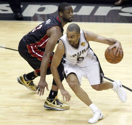 San Antonio Spurs' Tony Parker of France drives on Miami Heat's Dwyane Wade during the first half in Game 2 of their NBA Finals basketball series in San Antonio
