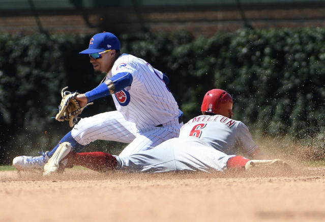 Cincinnati Reds' Billy Hamilton (6) steals second base as Chicago Cubs second baseman Javier Baez (9) makes a late tag during the sixth inning of a baseball game Saturday, July 7, 2018, in Chicago. (AP Photo/David Banks)