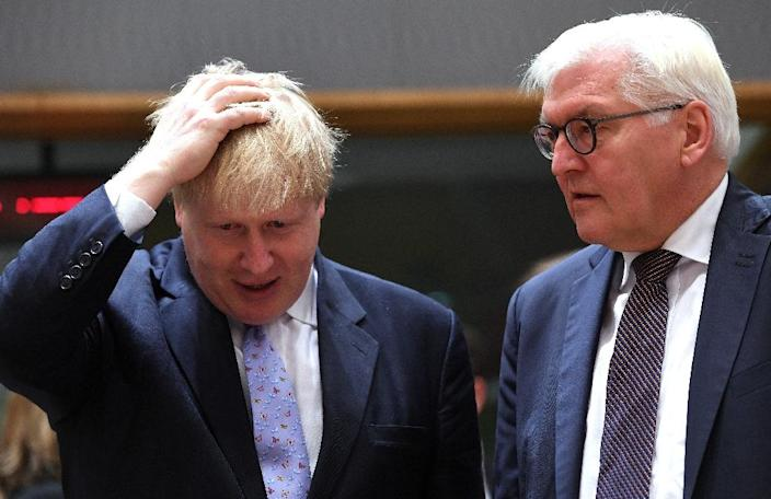 British Foreign Secretary Boris Johnson (left) talks to his German counterpart Frank-Walter Steinmeier before a meeting at the European Council in Brussels, on January 16, 2017 (AFP Photo/EMMANUEL DUNAND)