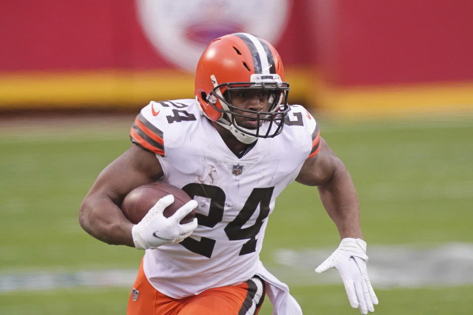 FILE - Cleveland Browns running back Nick Chubb carries the ball during the second half of an NFL divisional round football game against the Kansas City Chiefs in Kansas City, Mo., in this Sunday, Jan. 17, 2021, file photo. Chubb wants to go on a long run with the Browns. Entering the final season of his rookie contract, Chubb, who has rushed for 2,561 yards over the past two seasons and become a fan favorite in Cleveland, said his agent has had talks with the team about a long-term contract extension. (AP Photo/Charlie Riedel, FIle)