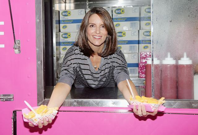"""Tina Fey hands out cheese friesat the launch event for the Broadway musical production of her film """"Mean Girls."""""""