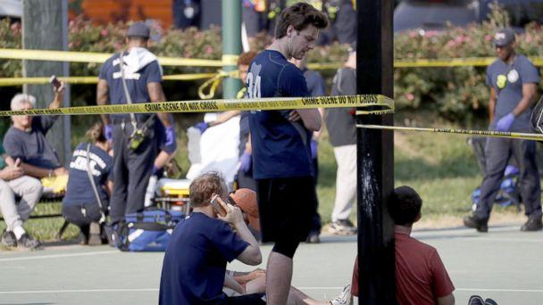 PHOTO: People gather near the scene of a shooting at the Republican Congressional baseball team practice in Alexandria, Va, June 14, 2017. (Shawn Thew/EPA)