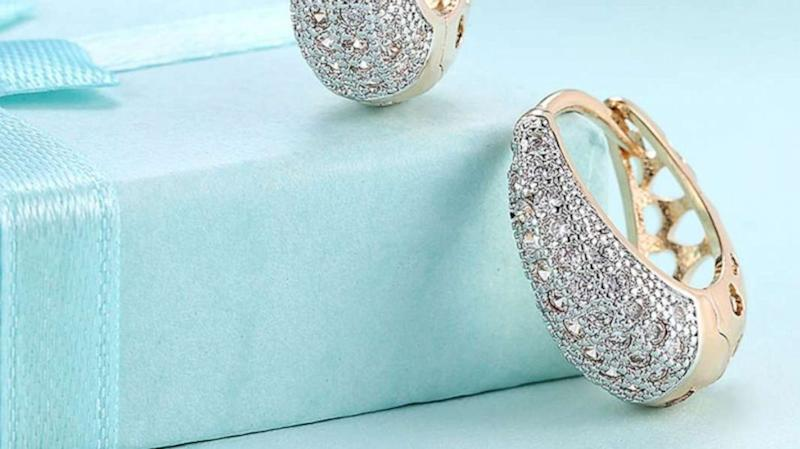 These Swarovski crystal-adorned huggie earrings are on sale for under $12