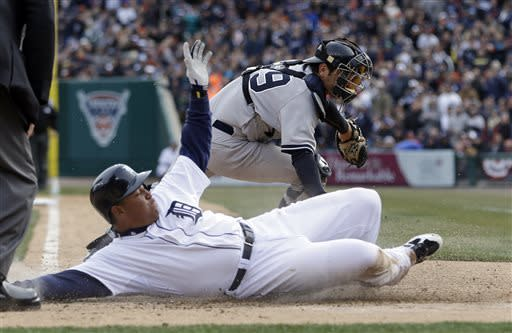 Detroit Tigers' Miguel Cabrera beats the tag of New York Yankees catcher Francisco Cervelli to score on a sacrifice fly by Victor Martinez during the fifth inning of a baseball game in Detroit, Saturday, April 6, 2013. (AP Photo/Carlos Osorio)