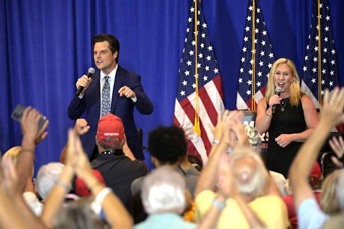 Rep. Matt Gaetz, R-Fla., left, and Rep. Marjorie Taylor Greene, R-Ga., address attendees during a Florida rally in May.