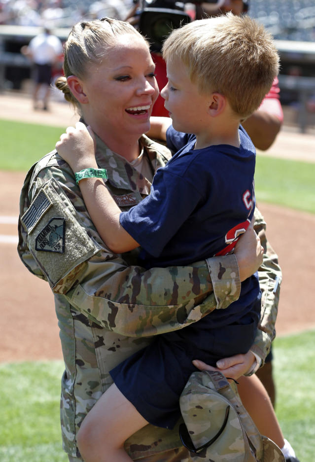 United States National Guard Tech. Sgt. Andrea Carrothers, left, returning from a six-month deployment to Qatar, surprises her six-year-old son William during ceremonies on Armed Forces Appreciation Day before the Minnesota Twins and the Baltimore Orioles baseball game Sunday, July 8, 2018, in Minneapolis. (AP Photo/Jim Mone)