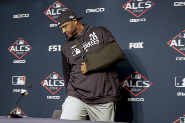 New York Yankees pitcher CC Sabathia arrives at a news conference to answer questions before Game 5 of baseball's American League Championship Series against the Houston Astros, Friday, Oct. 18, 2019, in New York. (AP Photo/Seth Wenig)