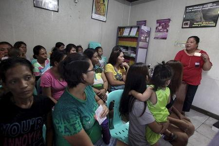 Women attend a lecture on family planning at a reproductive health clinic run by an Non-Governmental Organization (NGO) in Tondo city, metro Manila