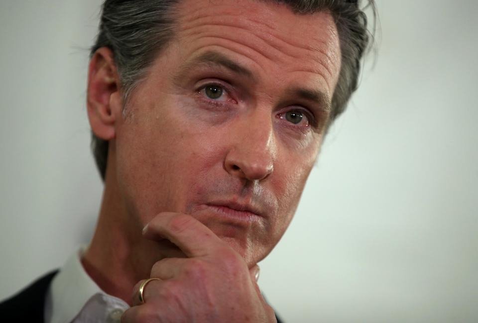 OAKLAND, CALIFORNIA - JANUARY 16: California Gov. Gavin Newsom looks on during a a news conference about the state's efforts on the homelessness crisis on January 16, 2020 in Oakland, California. Newsom was joined by Oakland Mayor Libby Schaaf to announce that Oakland will receive 15 unused FEMA trailers for the city to use as temporary housing and as mobile health and social services clinics for the homeless. Newsom signed on executive order on January 8 to deploy 100 trailers and crisis response teams to areas in need across the state.  (Photo by Justin Sullivan/Getty Images)