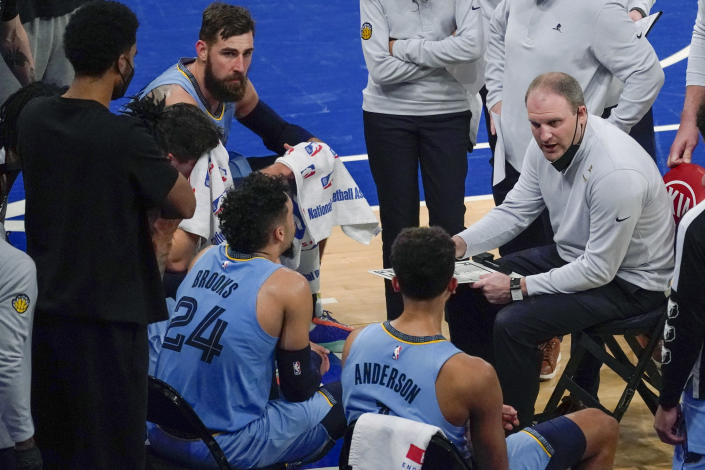 Memphis Grizzlies coach Taylor Jenkins, right, talks to players during a timeout in the second half of an NBA basketball game against the New York Knicks, Friday, April 9, 2021, at Madison Square Garden in New York. (AP Photo/Mary Altaffer, Pool)