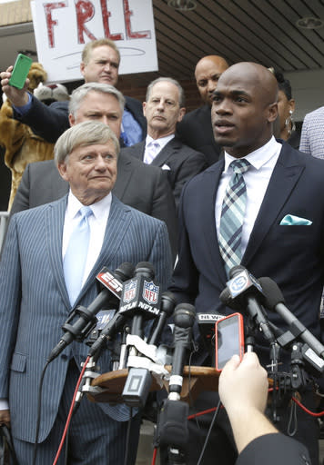Minnesota Vikings running back Adrian Peterson, right, and his attorney Rusty Hardin, left, speak to the media after pleading no contest to an assault charge Tuesday, Nov. 4, 2014, in Conroe, Texas. (AP Photo/Pat Sullivan)
