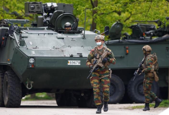 Manhunt for a Belgian soldier who threatened a virologist, in Maasmechelen
