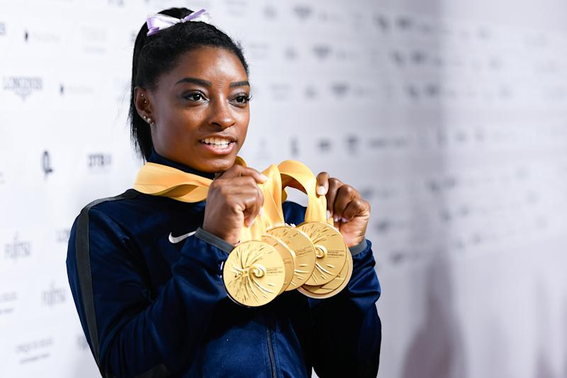 13 October 2019, Baden-Wuerttemberg, Stuttgart: Gymnastics: World Championships, apparatus finals, women: Simone Biles from the USA has 5 gold medals in her hands. Photo: Tom Weller/dpa (Photo by Tom Weller/picture alliance via Getty Images)