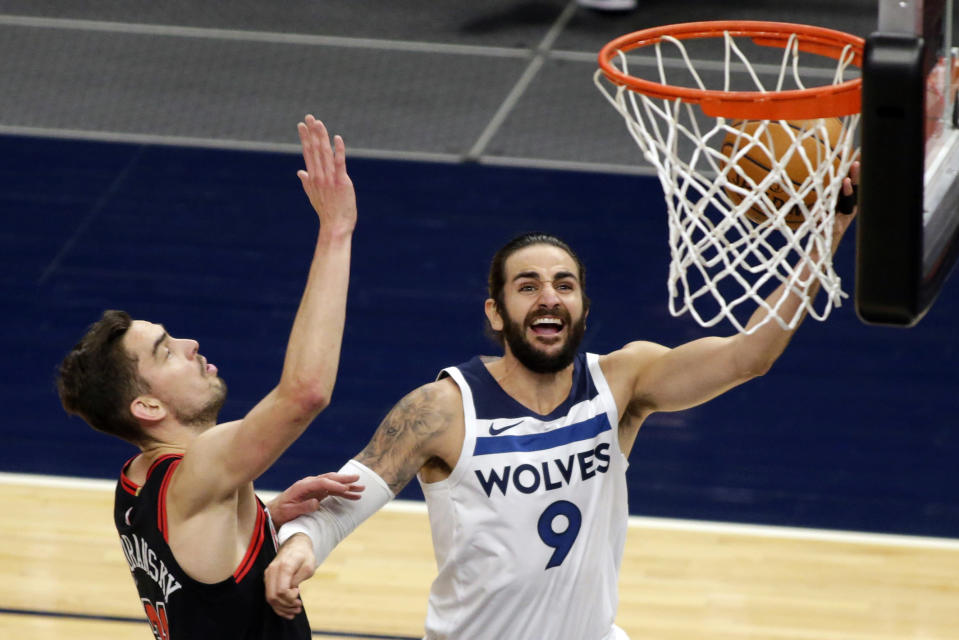 Minnesota Timberwolves guard Ricky Rubio (9) shoots as Chicago Bulls guard Tomas Satoransky (31) defends in the first quarter of an NBA basketball game, Sunday, April 11, 2021, in Minneapolis. (AP Photo/Andy Clayton-King)