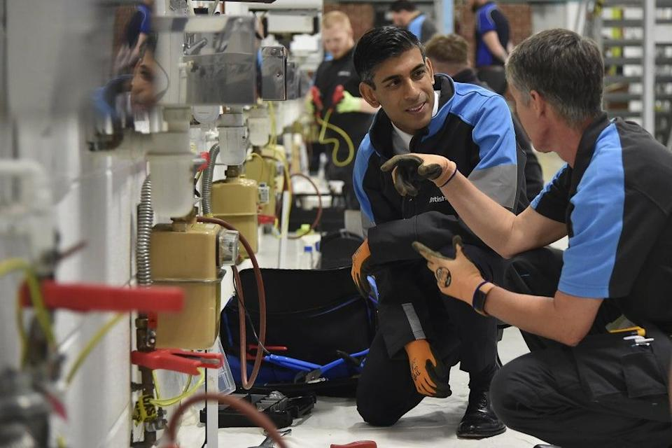 Chancellor of the Exchequer Rishi Sunak listens to an employee during a visit to a British Gas training academy (Rui Vieira/PA) (PA Wire)
