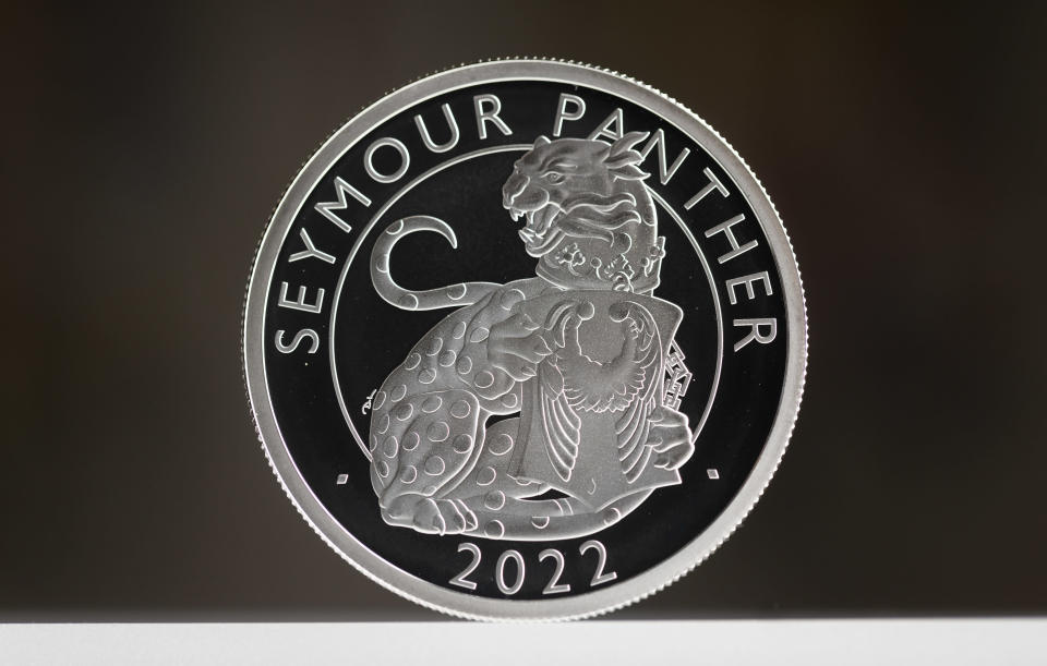 The first coin in the collection was unveiled at Hampton Court Palace (Matt Alexander/PA)