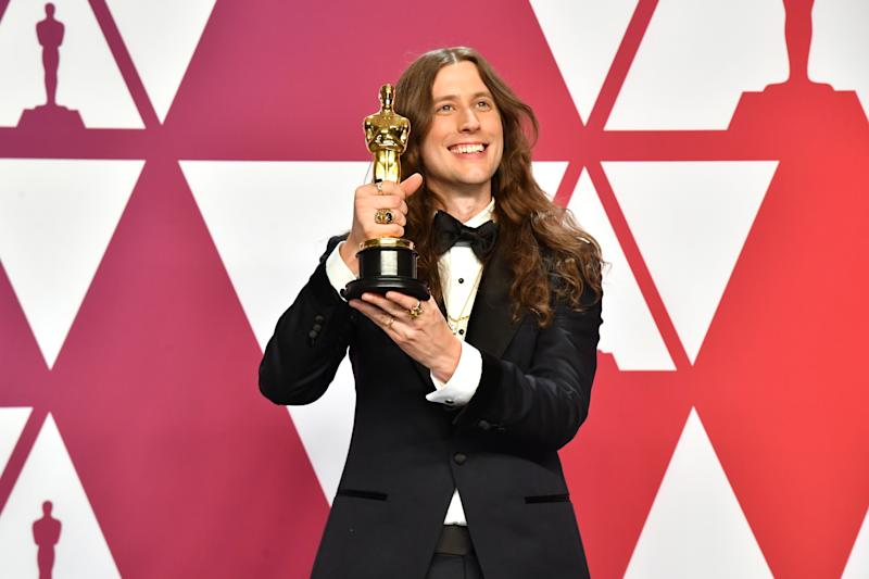 "Ludwig Goransson poses with the Best Original Score Oscar for ""Black Panther"" on February 24, 2019. (Photo by Jeff Kravitz/FilmMagic)"