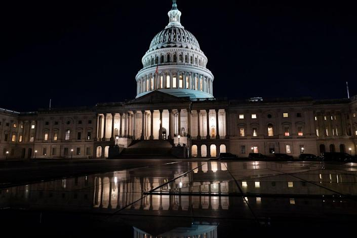 The Capitol is seen at dusk as work in the Senate is stalled on the Democrats' $1.9 trillion COVID-19 relief bill, in Washington, Friday, March 5, 2021.