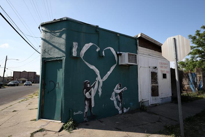 A painting by the graffiti artist Bandit of two children playing with toilet paper is seen on an abandoned building in New Orleans on April 03, 2020. A USA TODAY analysis of rental allocation to all 50 states found Alaska, Vermont and Wyoming will receive substantially more money per eligible renter than other states.