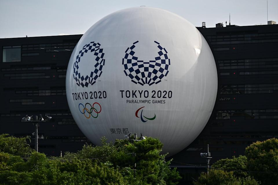 The Tokyo 2020 Olympic and Paralympic logos are displayed on the Hinomaru driving school building in Tokyo on June 29, 2020. (Photo by CHARLY TRIBALLEAU / AFP) (Photo by CHARLY TRIBALLEAU/AFP via Getty Images)