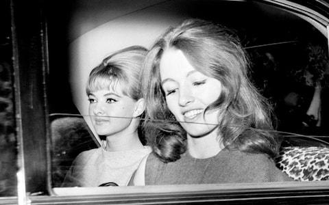 Mandy Rice-Davies and Christine Keeler leave the Old Bailey after the first day of the Profumo trial