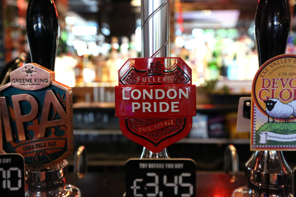 London Pride beer is seen for sale at a Wetherspoon pub in North London, Wednesday, June 13, 2018. A major U.K. pub chain will stop serving French Champagne and German wheat beers next month and offer more British drinks to prepare for the country's departure from the European Union. Tim Martin, the founder of the JD Wetherspoon chain and a strong advocate for Brexit, says the aim is to make the business more competitive for when Brexit becomes a reality. (AP Photo/Robert Stevens)