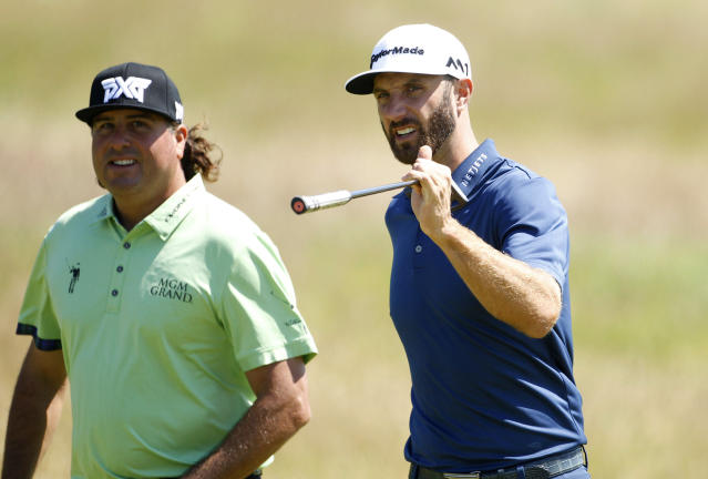 FILE - In this July 17, 2017, file photo, Pat Perez, left, and Dustin Johnson walk along the 5th hole during the second practice day at the British Open Golf Championship at Royal Birkdale in Southport, England. Perez made it to the Tour Championship for the first time in his 16-year career on the PGA Tour. (AP Photo/Peter Morrison, File)