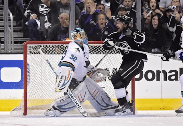 Los Angeles Kings right wing Justin Williams, right, celebrates his goal as San Jose Sharks goalie Alex Stalock looks on during the first period in Game 6 of an NHL hockey first-round playoff series, Monday, April 28, 2014, in Los Angeles. (AP Photo)