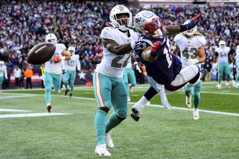 FOXBOROUGH, MA - DECEMBER 29: Tae Hayes #22 of the Miami Dolphins breaks up a pass intended for NKeal Harry #15 of the New England Patriots during the second quarter of a game at Gillette Stadium on December 29, 2019 in Foxborough, Massachusetts. (Photo by Billie Weiss/Getty Images)