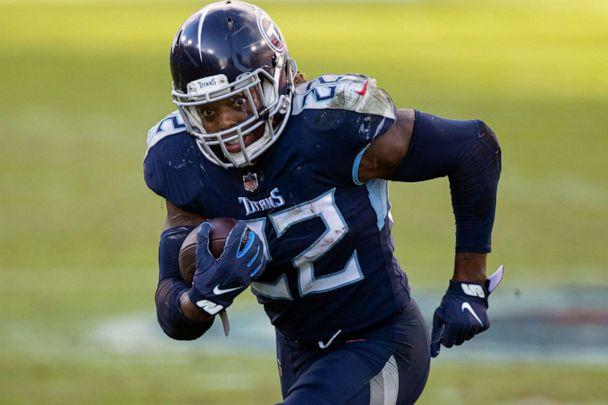 PHOTO: FILE - Tennessee Titans running back Derrick Henry runs with the ball against the Detroit Lions during the fourth quarter of an NFL football game in Nashville, Tenn., in this Sunday, Dec. 20, 2020, file photo. (Brett Carlsen/AP)