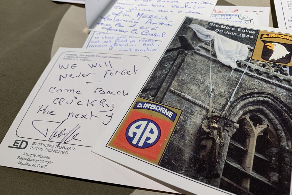 In this Tuesday, Dec. 15, 2020 photo, A handwritten post card from a resident of Sainte-Mere-Eglise, France thanks U.S. paratroopers for liberating their village from Nazi occupation, seen at Fort Bragg, N.C. The town sent 500 notes to Fort Bragg, North Carolina which were read by soldiers. 12,000 82nd paratroopers fought to liberate Normandy on June 6th, 1944. 1,400 were lost their lives in the invasion. (AP Photo/Sarah Blake Morgan)