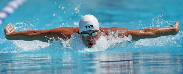 Ryan Lochte competes in the men's 200-meter individual medley time trial at the U.S. national swimming championships in Stanford, Calif., Wednesday, July 31, 2019. Lochte is returning from a 14-month suspension. (AP Photo/David J. Phillip)