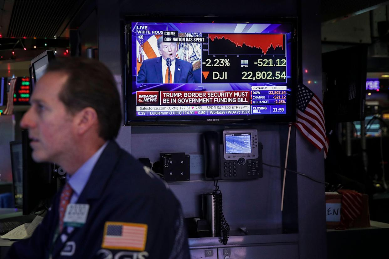 President Donald Trump is displayed on a monitor as a trader works at his desk ahead of the closing bell on the floor to he New York Stock Exchange (NYSE). (Photo by Drew Angerer/Getty Images)