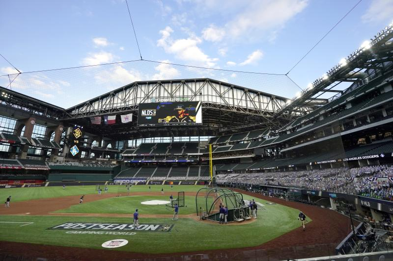 The roof at Globe Life Field is opened as the Los Angeles Dodgers take batting practice before Game 3 of the baseball team's NL Division Series against the San Diego Padres on Thursday, Oct. 8, 2020, in Arlington, Texas. (AP Photo/Tony Gutierrez)