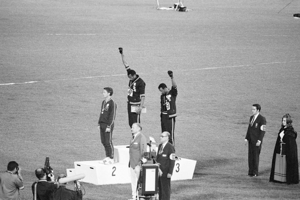 "<p>Tommie Smith and John Carlos, gold and bronze medalists in the 200-meter run at the 1968 Olympic Games, engage in a victory stand protest against the oppression of Black people in the United States. With heads lowered and fists raised in the Black power salute, they refuse to recognize the American flag and national anthem. Australian Peter Norman is the silver medalist.</p><p><strong>RELATED: </strong><a href=""https://www.redbookmag.com/life/news/a48951/kindergartner-recreated-iconic-women-black-history-month/"" rel=""nofollow noopener"" target=""_blank"" data-ylk=""slk:This Kindergartner Dressed Up As Iconic Black Women Every Day of Black History Month"" class=""link rapid-noclick-resp""><strong>This Kindergartner Dressed Up As Iconic Black Women Every Day of Black History Month</strong></a></p>"