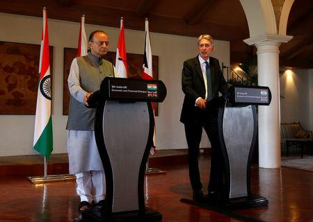 Britain's Chancellor of the Exchequer Philip Hammond (R) speaks during a joint news conference with India's Finance Minister Arun Jaitley in New Delhi, India April 4, 2017. REUTERS/Altaf Hussain