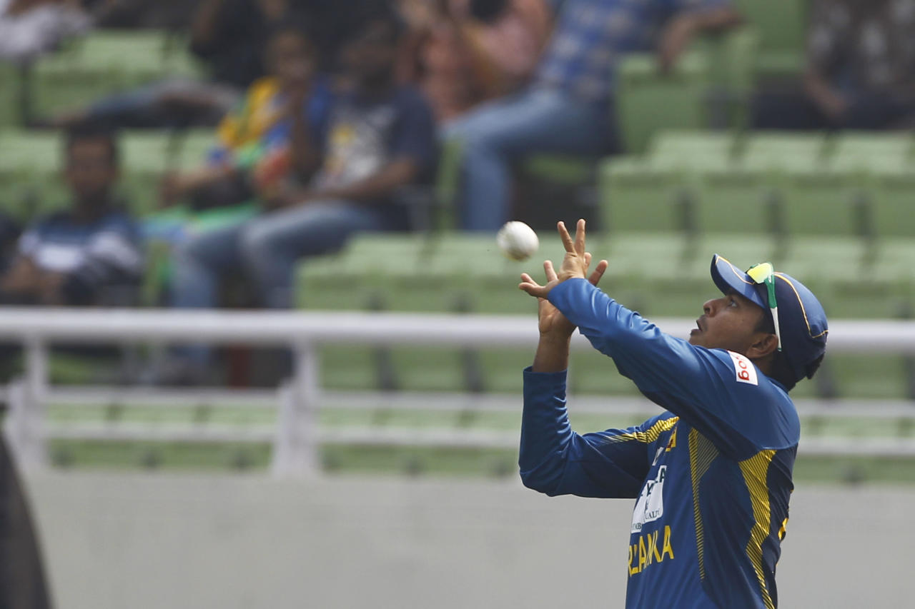 Sri Lanka's Angelo Perera prepares to make a catch to dismiss Bangladesh's Shamsur Rahman on the third one day international cricket match between them in Dhaka, Bangladesh, Saturday, Feb. 22, 2014. (AP Photo/A.M. Ahad)