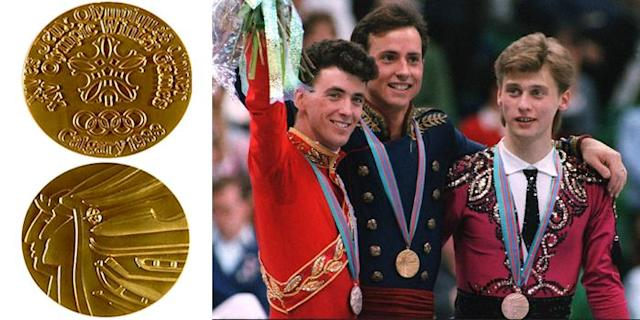 <p>The Calgary 1988 medal features the profiles of an athlete with an olive wreath and an Indian with a headdress.<br> (IOC photo; Medalists for Men's Figure Skating, Canadian Brian Orser, American Brian Boitano, and Ukrainian Viktor Petrenko/photo by Daniel Janin/AFP/Getty Images) </p>