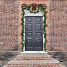 <p>A trio of apple rings look great over this doorway. <i>(Photo: Christian Carollo/Say Hello to America)</i></p>