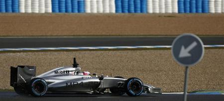 McLaren Formula One driver Jenson Button of Britain drives the new MP4-29 during pre-season testing at the Jerez racetrack in southern Spain