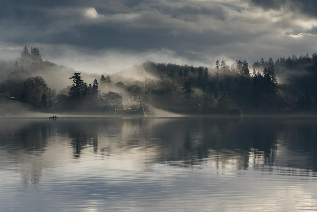 'Fishermen on Loch Ard', Trossachs, Scotland: Paul Bundle won the 'Living the View' adult class for this mesmerising photo taken at dawn in March. (Paul Bundle, Landscape Photographer of the Year)