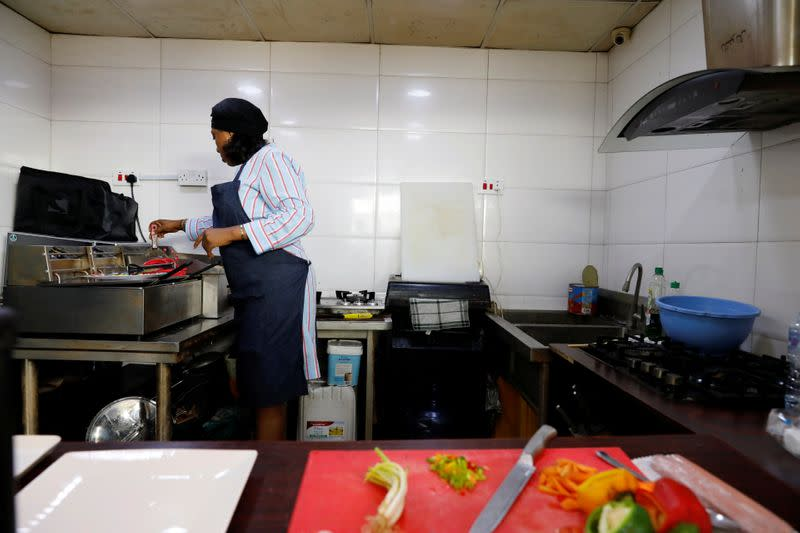 Melanie Igbe, head chef at Cafe de Elyon, prepares food in the kitchen at the cafe in Lekki, Lagos