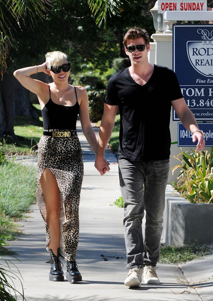 October 19, 2012: Miley Cyrus and Liam Hemsworth take a romantic stroll together in Los Angeles, California. While walking the two lock hands.