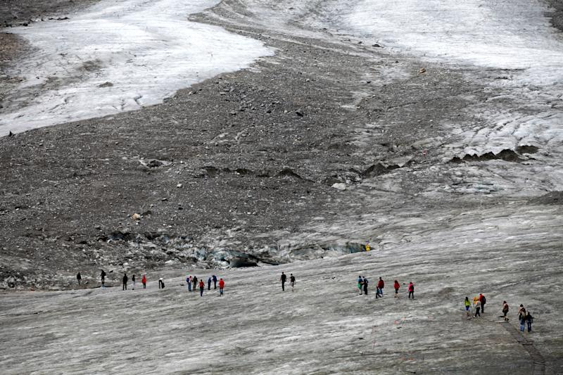 People walk on Pasterze Glacier, Austria's largest glacier, located in the Hohe Tauern mountain range, in the Austrian province of Carinthia. (Photo: Lisi Niesner/Reuters)